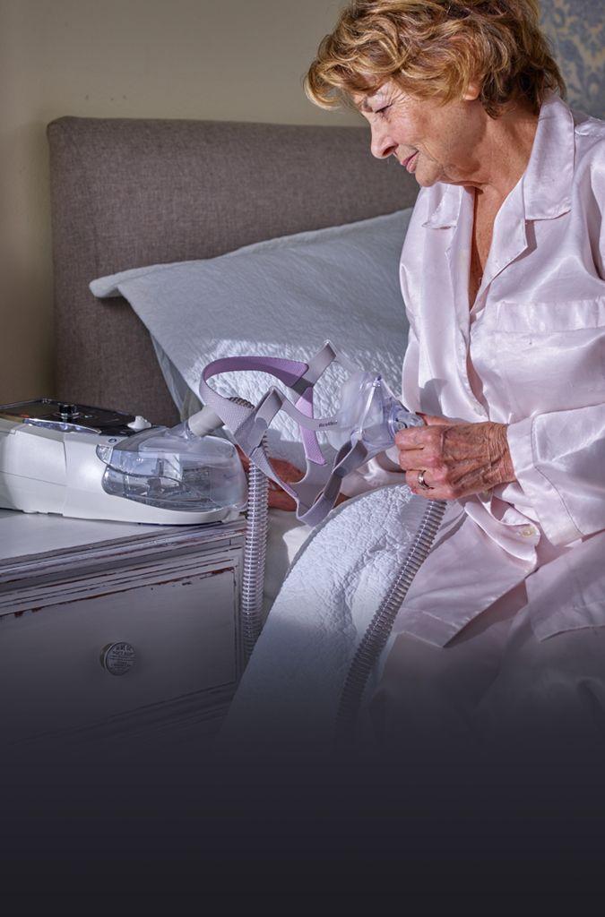 ventilation-ventilation-woman-sitting-on-bed-using-stellar